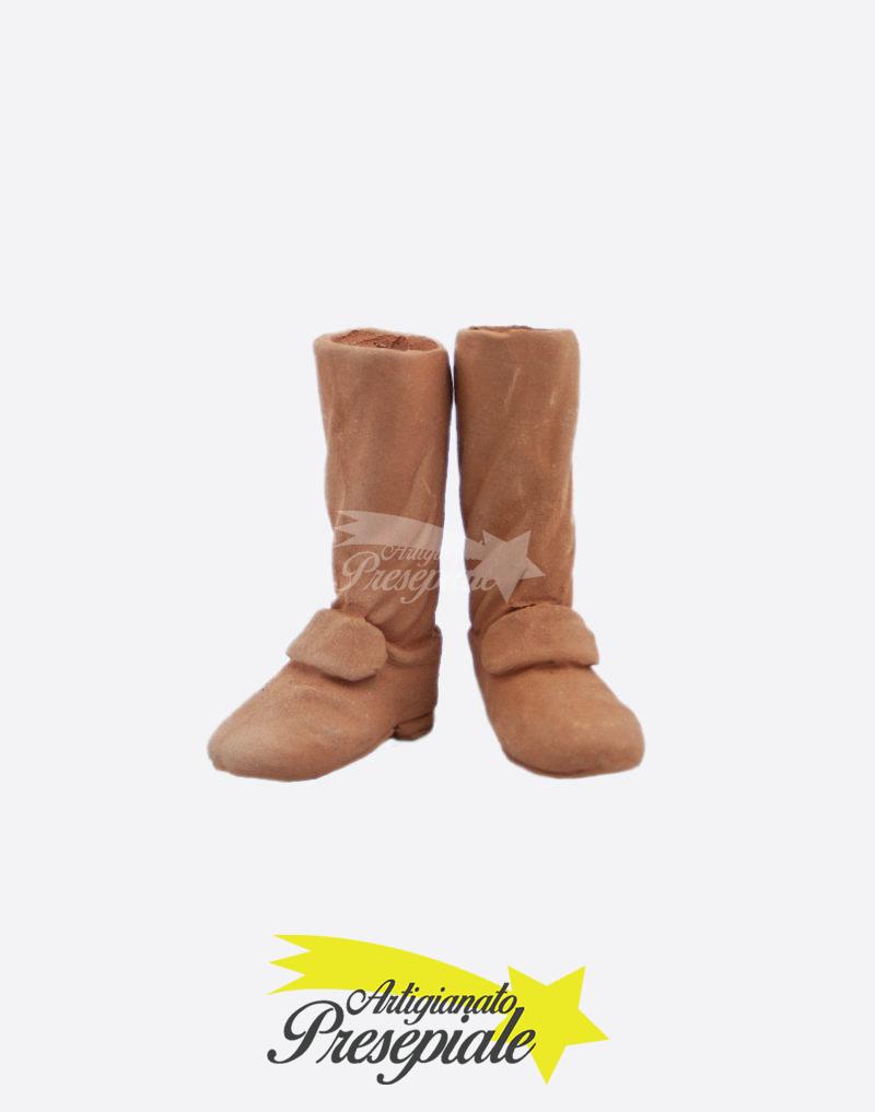 Piedi con scarpe pastori 30-35 cm.