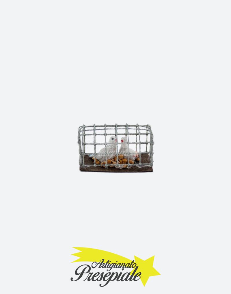 Gabbia in metallo con piccioni