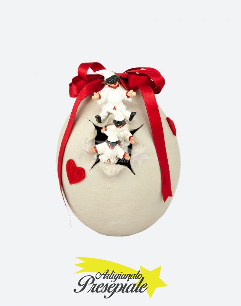 Uovo di pulcinella con fiocco rosso
